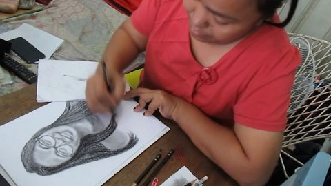 Doting teacher spends hours drawing portraits of her students