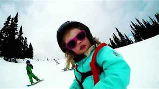 Kids Show Parents How It's Done on Snowboarding Adventure - Video