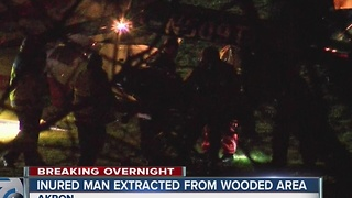 Crews rescue a man stuck in the woods in Akron