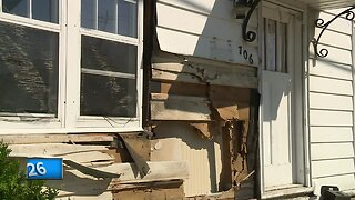 Truck drives into house