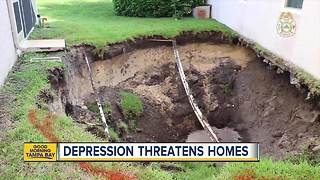 Large depression opens in Pasco Co. neighborhood