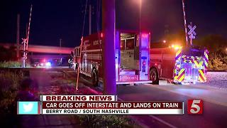 Car Goes Off Interstate, Lands On Train - Video