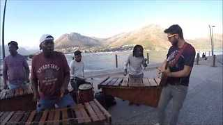 Talented Tourist Jams With Buskers in Cape Town - Video