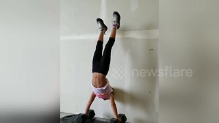 Incredible feat: Four-year-old performs series of hand-stand pushups