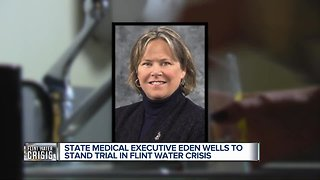 Michigan's medical chief to stand trial on Flint manslaughter charges