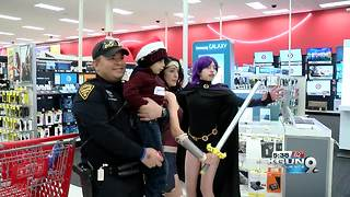 Police officers take kids shopping for toys - Video
