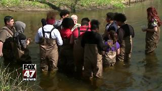 Students release salmon into local creek