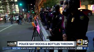 4 arrested in downtown Phoenix after protesters clash with police after President Trump rally - Video
