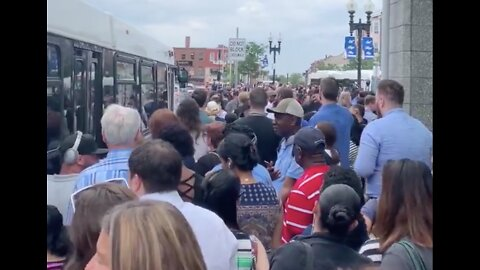 Passengers Crowd Shuttle Bus Service After Power Issue Shuts Down Boston's Blue Line