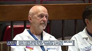 Doctor says officer sustained 12-inch wound in Flint airport stabbing - Video
