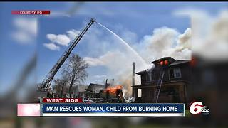 Man rescued pregnant woman, child from burning Indianpaolis home - Video