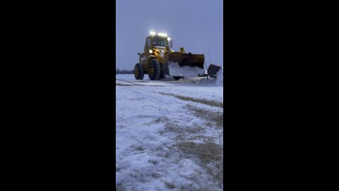 Plowing snow with a front end loader