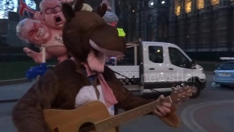 Christmas-themed protesters on the streets of London ahead of no-confidence vote