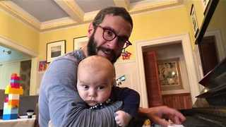 Dad Plays 'Winter Cold Blues' to Keep His Infant Son Calm - Video