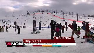 People enjoy the outdoors despite bitter cold - Video