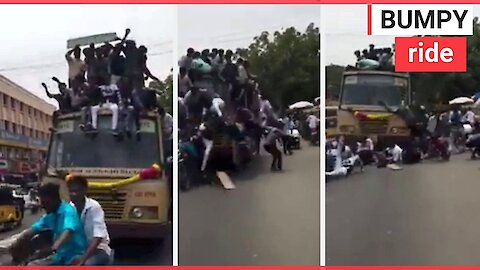Kids celebrate by jumping on top of bus