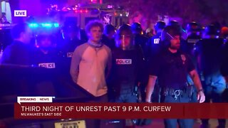 Police make arrests on Milwaukee's east side as people stay out past curfew
