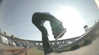 Teen skater takes rail between legs before landing on head - Video
