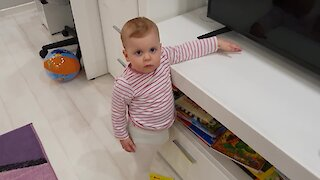 Jealous baby throws tantrum when her parents hug