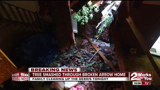 A tree goes through a Broken Arrow woman's home as a tornado rips through Green Country - Video