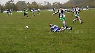 Non league footballer takes comical tumble after standing on ball - Video