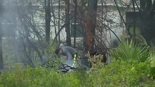 Fire crews are working to contain a brush fire in Lehigh Acres - Video