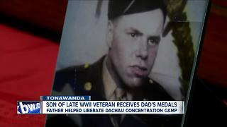 Son of Late WWII Veteran Receives Dad's Medals - Video