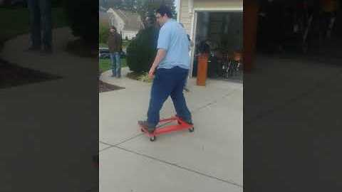 Man Skates Trolley Down Driveway on Moving Day and Hilarity Ensues