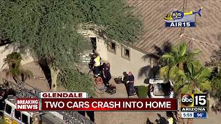 Two cars crash into home in Glendale - Video