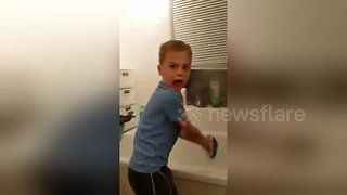Son's reaction is priceless when dad scares him from behind