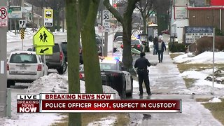 Police officer shot, suspect in custody - Video