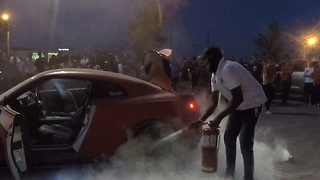 Occupants bail out of supercar as it catches on fire at charity event