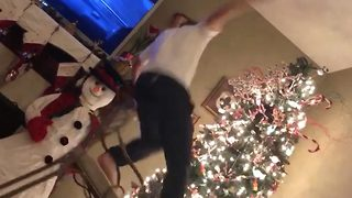 Ho ho no! – Man falls off chair when trying to decorate his Christmas tree - Video