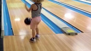 Strike three – Toddler bowls perfect ball - Video