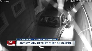 Surveillance video catches man breaking into car - Video