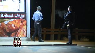 Police investigating armed robbery at Lansing pizza shop - Video