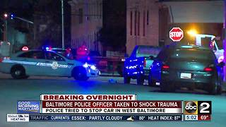 Baltimore City officer injured while trying to stop car - Video