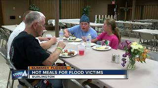 Neighbors serve hot meals to flood victims - Video