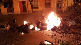 Bins Set Alight in Disturbances Following Death of Madrid Street Vendor - Video
