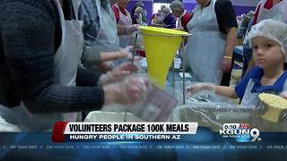 Hundreds of volunteers pack meals for people in need
