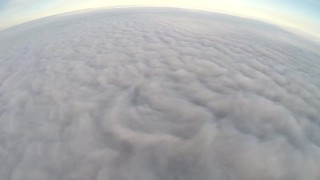 Jaw-dropping paragliding session over sea of clouds