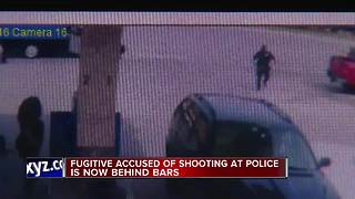Police arrest man accused of shooting at officers - Video