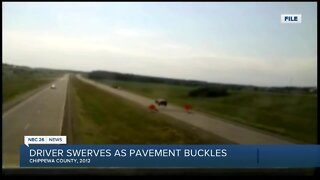 Video shows driver swerving after hitting buckled pavement