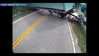 Dramatic video shows tractor-trailer hit school bus carrying special needs student