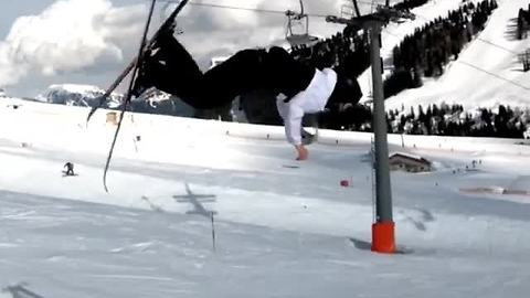 Daredevil Skier Opens A Beer Can During Mid-Air Backflip