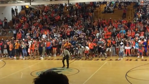 Cop Busts Out With Dance Moves At Pep Rally