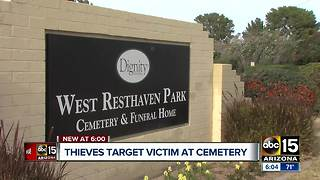 Woman's purse stolen while visiting the grave of her father and brother - Video