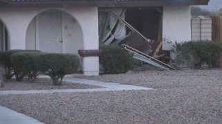 Car crashes into a house - Video