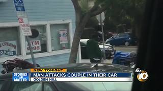 Man attacks couple in car - Video