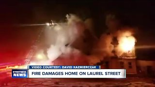 Unoccupied Laurel Street home goes up in flames